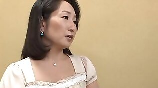 Mature Asian babe getting her full lips stretched lovingly