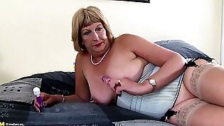 granny with bright hair and large tits is opening up her vagina