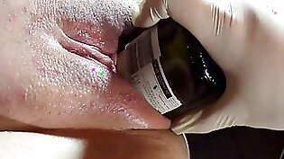 Aisha and Jmac playing a bottle with wet pussy
