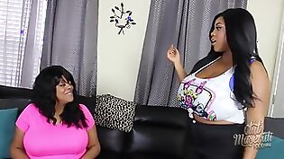 Breasty black haired lesbo Eve Taylor teases with her tits