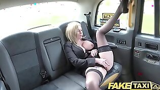 blonde is in the back of the taxi getting her pussy pounded