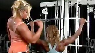 Buxom lesbians eating each others tasty pussies at Gym